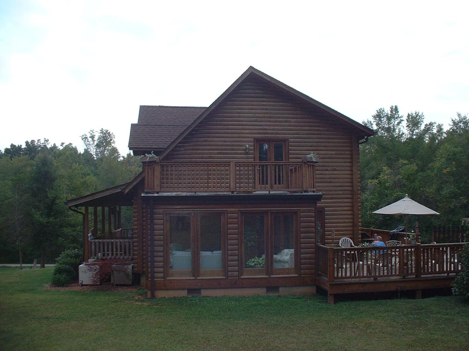 the sky hawk 2 story custom log home plan